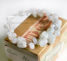 Tons of Moonstone  StrungOut guitar string bracelet by alizarine, $50.00