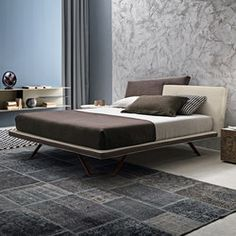 "Meeting bed upholstered with Econabuk Tecnopelle and Mia Tecnopelle. I-night system base units D.469 in matt beige seta lacquer with ""vintage"" drawer.."