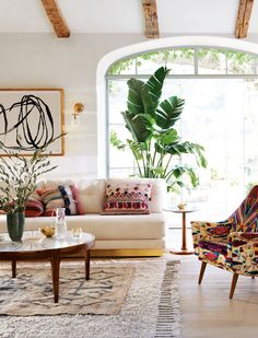 Living room with pops of color | shop the look: sofa - chair - coffee table - large rug - small rug - side table - art - striped pillow - pink pillow - green vase Follow Gravity Home: Blog - Instagram...