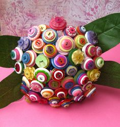 Button bouquet. Ooh! Just been hit by a craft bunny. What about a fabric ball, covered in buttons? Though perhaps not Joe-safe.