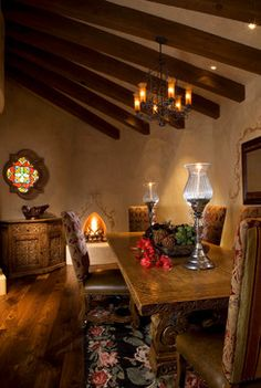 Completely in love with this room: the kiva fireplace, the stained-glass window, the magnificent rug and the carved wood... beautiful!!! Custom Wood Carving - David Naylor