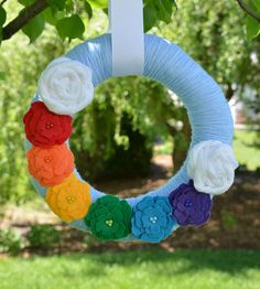Hey, I found this really awesome Etsy listing at http://www.etsy.com/listing/152472326/rainbow-summer-yarn-wreath-spring-wreath