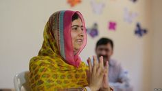 Nobel Peace Prize laureate Malala Yousafzai gestures inside a classroom at a school for Syrian refugee girls, built by the NGO Kayany Foundation, in Lebanon