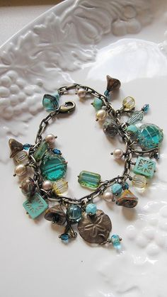 Love the aqua colors, glass beads and pearls