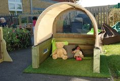 Cosy Den - a permanent outdoor cosy area for babies and toddlers protected from sunshine and drizzle.