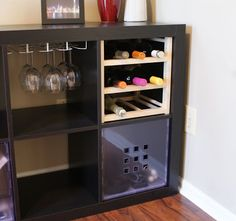 "Brad adds a wine nook in his Expedit. Enough to stash away a few bottles of red and wine as well as glasses. ""I love my Expedit unit. It has become a handy storage and decorative center piece in my home. I hacked a Hutten wine bottle storage to fit into the 2-by-4 Expedit. The [&hellip"