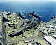 Forrestal class USS Ranger (CVA-61) in dry dock, Midway class USS Coral Sea (CVA-43), and the Essex class USS Hancock (CVA-19) in 1971