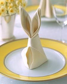 Transform dinner napkins into bunnies for a festive Easter table with this easy fold.