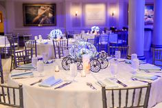 Cinderella pumpkin carriage inspired reception centerpieces at a Walt Disney World Wishes Wedding