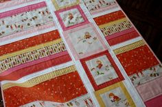 I like the idea of incorporating the blocks and the strip piecing...very nice!FFA3 Baby QUilt by Chasing Cottons, via Flickr