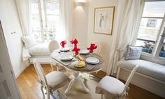 Dining Area And Window Seats In A Parisian Apartment