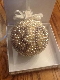 "30th Anniversary Christmas ornament. 4"" styrofoam ball covered in pearl beads pinned/glued down and decorated with a sheer ribbon. I recommend using a thimble and some dress making pins."