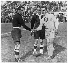 Goalkeepers and captains Gianpiero Combi (Italy) and František Plánička (Czechoslovakia) shake hands before the 1934 World Cup Final in Rome