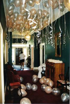 simple wedding decor. release helium filled latex in ceiling with long streamers and fill floor with airfilled balloons for a magical entrance. www.check-it-outballoons.com