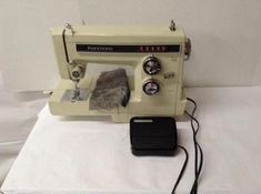 1960 singer sewing machine with cabinet value