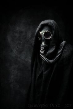 This image is so dark, yet it lets one create a story from its simple creepiness. I imagine a mad survivor of some apocalypse still wearing their gas mask years later. <<idk who you are but I like your take on it