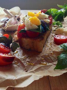 Heirloom tomato & fresh buffalo mozzarella bruschetta with a soft-boiled egg on top at feedmedearly.com   Rosemary focaccia, garlic, mozzarella cheese, purple basil
