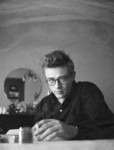 A reflective moment of actor  James Dean in this black and white portrait. James Dean always exuded a simple, effortless men's style.