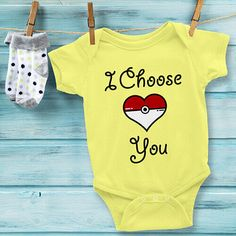 """This sweet """"I Choose You"""" Pokemon Baby Onesie features a heart-shaped Pokeball and would make the perfect birthday or Baby Shower Gift. It fit babies 3-24 months, and is available in White, Lemon, Heather Grey, Baby Blue, Pink and Grass colors. Use coupon code PINFIVE for 5% off!"""