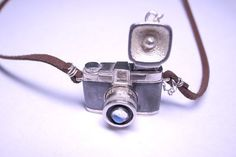 *Item* Leather Necklace: 66cm Camera:3cmx2cm Black parts are oxidized. Camera lens is top with a Moonstone. Because moonstone is a natural material ,every piece might be a little bit different. You can also require to change other stone as you like. * Me* All of Silver jewelry is handmade