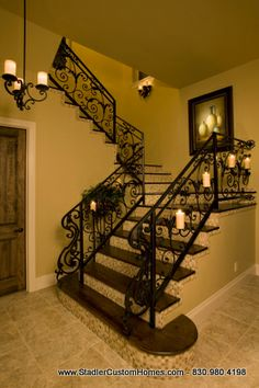 Stadler Custom Homes. Wrought iron and tile. Spanish mission style is such a clean yet warm atmosphere.