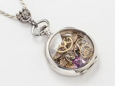 Pocket watch case necklace containing all types of crystals and gemstones. I carefully pick antique brass and sometimes gold pocket watch case necklaces