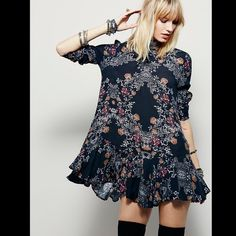 Free People printed dress ❗️SOLD OUT COLOR❗️Printed crepe tunic with ruffled hem and low V-back with strap detail. Hip pockets.  127h190   Retail: $108 Ivory (antique): Large Black (raven): Large  ❤I have over 300 new with tag Free People items for sale! I love to offer bundle discounts!  ❤No trades. love the item but not the price? Submit an offer! Free People Dresses Long Sleeve
