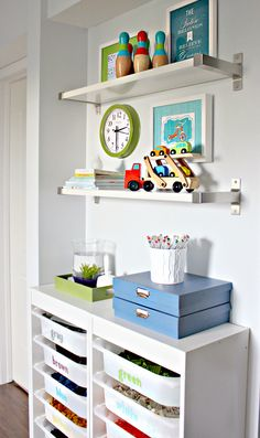 "Lego Storage using IKEA Trofast cabinets & bins and Ekby wall shelves | iHeart Organizing - Jen says, ""...have a large bin to hold in-progress builds and random pieces...re-sort that holding bin every few months."""