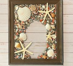 "13""x 16"" Beach Glass Wall and/or Window Art/Seashell Art/Resin Art/Unique Coastal Decor/Beach House Decor/Sun Catcher/Great Christmas Gift  Handmade in South Carolina with high quality materials (seashells, crushed glass, crushed shells, starfish) and secured with care. The design is bonded (not Nautical Wall Art, Coastal Wall Art, Coastal Decor, Seashell Art, Starfish, Crushed Glass, Sea Glass Art, Window Art, Beach Art"