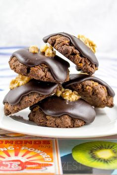 Chocolate Crunch Cookies - Rich, ultra chocolaty cookies with chocolate icing and a lone walnut center! Absolutely delicious!! @almondtozest