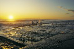Swimmers at Avalon Rock Pool at sunset, Sydney. Image Susan Wright, Tourism NSW
