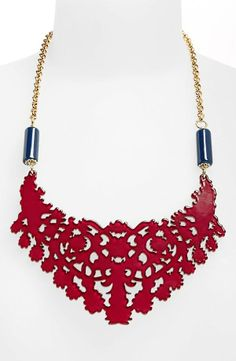 Falling in love with this red statement necklace.