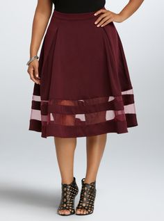 Description This cute plus size skirt features a double knit ...