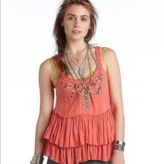 🎉HP🎉Free People orange meadow ballerina tank 🎉🎉🎉Total Trendsetter Host Pick 12/6🎉🎉🎉Adorable Free People embroidered tank top. I would describe the color as coral. Free People Tops Tank Tops