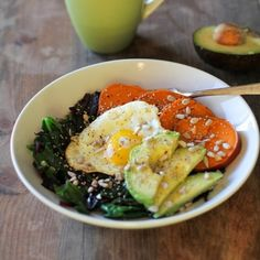 Sweet potato breakfast bowls with greens, avocado, and sunflower seeds.