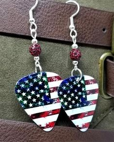 Distressed American Flag Guitar Pick Earrings with Red Pave Beads – SimplyRaevyn Military Jewelry, Clip On Earrings, Drop Earrings, Guitar Picks, Stocking Stuffers, American Flag, Pendant Necklace, Sterling Silver, Beads