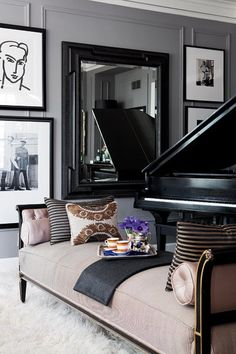 Black and white art hung high and low. Also great pillow mix on tuft chaise | Parlour: David Jimenez in Spaces KC