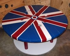 Industrial wire reels were torn down, sanded, painted, and rebuilt for this coffee table. The union jack is an old favorite symbol of ours, and it just seemed to jive with the ModSquared ideals. The table measures just over 34 inches in diameter and a shade over 16 inches tall. Its solid and will stand the test of time. The top is made from a reel that held 350mcm cable which was used to retrofit a local southern California airport. The base is from a reel which held cable used in a large…