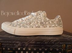 **Hello.... I currently have a 4 week turnaround time for these shoes. For international customers (outside the UK) you will need to add 7-10 days postage time to this. ***  These are the gorgeous & very popular canvas Converse Monos in all white. I have added a mix of crystals & pearls to the whole of each side of the shoe. The tongue is left plain. If you would like the tongue covered, it will be an extra £10 per pair. I add satin laces to the finished shoes. The result is a stunning pair…