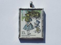 UK 13p Alice in Wonderland stamp encased in glass pendant. This stamp is part of the 1979 Year of the Child set.