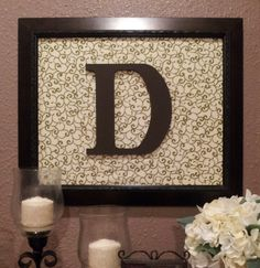 Looks simple enough to make....frame (can be painted any color), scrapbook paper and a wooden letter (painted any color)