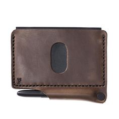 e777b025ff3 A high quality durable saddle stitched Horween leather wallet with a Fisher  Space Bullet pen and