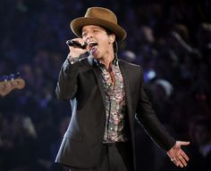 """Oh man, Mr. Bruno Mars. Where would I even begin? Like Neyo, he's a huge inspiration for me. His passion for music is so incredible that I'd love to be able to write about 'love' and 'hurt' the way he does. This image to me just displays his passion for what he does. This would be another """"Mastery"""" being held at its finest."""