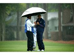 Matt Kuchar watches on during the rain on the 2nd hole in the second round of the RBC Heritage at Harbour Town Golf Links on April 18, 2014 ...