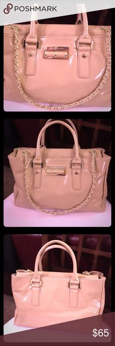 Ivanka Trump Beige Handbag with Gold Hardware Excellent, Gently Used Condition, Shows Minor Wear; Only Used a Handful of Times; Top Handles and Gold Chain Shoulder Strap; Magnetic Top Closure; Multiple Inside Zippered and Zipper-free Pockets; Spacious Inside with Iconic Ivanka Trump Lining; Gold Ivanka Trump Detailing on Front; Beige Vinyl Outside; Lovely, Classic Ladylike Handbag Adds a Touch of Upscale Posh to Any Outfit and Occassion! Ivanka Trump Signature Dust Bag Included!!⭐️Reasonable…