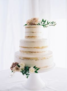Dreamy floral topped naked cake: http://www.stylemepretty.com/2016/03/14/organic-style-wedding-in-sacramento/ | Photography: Mariel Hannah - http://www.marielhannahphoto.com/
