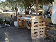 For those of you who don't have a potting table...look at this!  Garden Work Bench from Recycled Pallets
