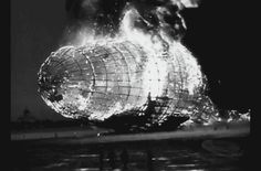 A portion of newsreel coverage as the front of the flaming Hindenburg crashes to the ground, with passengers and crew running for their lives. Naval Air Station Lakehurst, New Jersey, on May 6, 1937