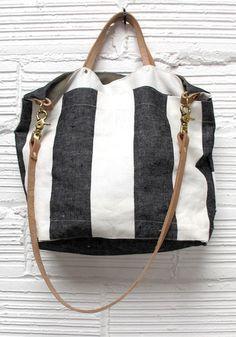 Ali Golden bag, for diapers? I hate diaper bag designs! http://www.aligolden.com/product/crossbody-bag-wide-stripe-taupe
