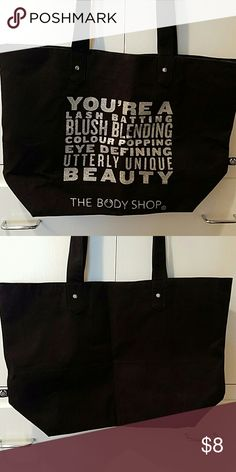 The Body Shop canvas tote This is a brand new canvas tote with a snap closure and one open pocket. The Body Shop Bags Totes